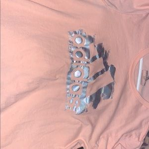 Small pink holographic adidas amplifier tee